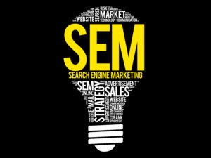 """search engine marketing image showing """"SEM"""" and other related search marketing terminologies forming a light bulb"""