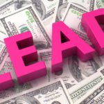 "cost per lead image showing the word ""LEAD"" in bright pink color sitting on top of stacks of dollar bills"