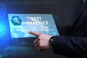 """digital marketing best practice image showing a tablet with the words """"best practice"""" on it and a person's finger clicking on an area on the tablet"""