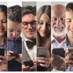 importance of personalization in marketing as shown in this image showing the happy faces of different types of people browsing their mobile phones
