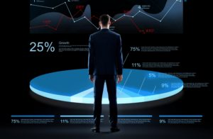 businessman with virtual chart hologram